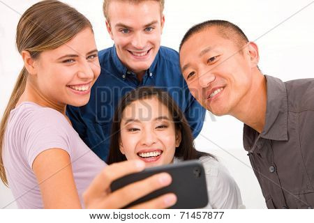 Group Of Multiethnic Friends Taking Self Portrait