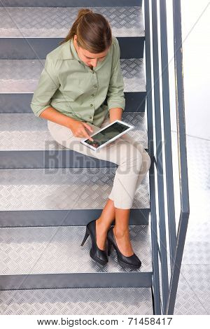 Woman Sitting Staircase Using Digital Tablet