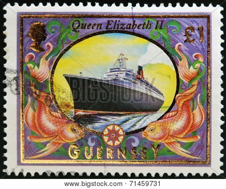 GUERNSEY - CIRCA 1999: A stamp printed in Guernsey shows Queen Elizabeth 2 (Liner) circa 1999