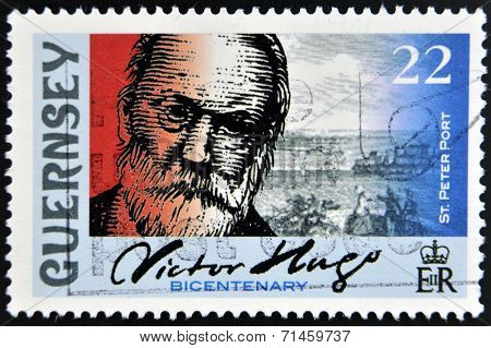 GUERNSEY - CIRCA 2002: A stamp printed in Guernsey shows Victor Hugo and St. Peter Port circa 2002