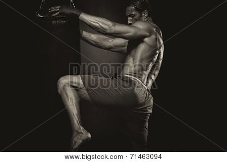 Mma Fighter Practicing Some Kicks With Punching Bag