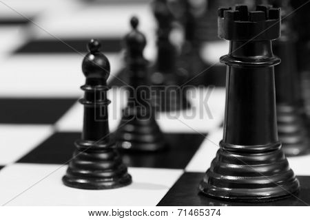 Black chess pieces, with focus on rook.