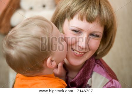 Little Son Kisses His Mom