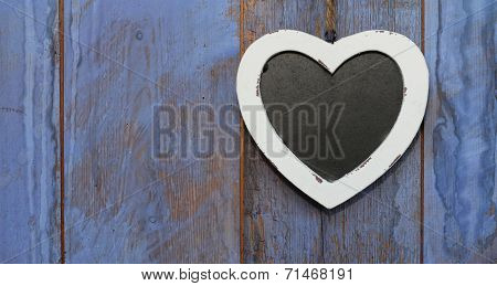 Heart shaped shabby chic chalk board with white wooden frame