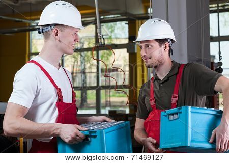 Handsome Workers Talking In Factory