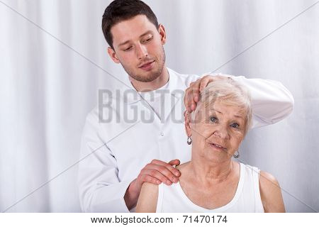 Physiotherapist Helping Patient With Neck Ache