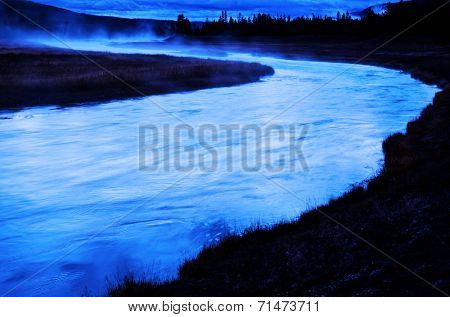 Wilderness River in Early Morning with steam rising from surface