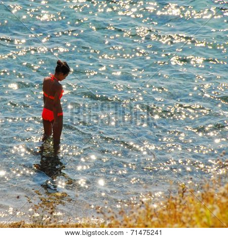 Girl In Sunny Sea Water