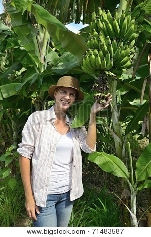 Agriculture: Woman visiting banana plantation