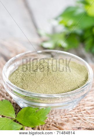 Lovage Powder On Wood
