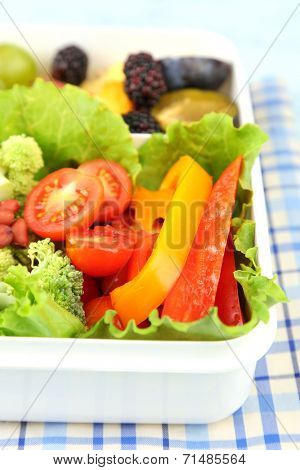 Tasty vegetarian food in plastic box, close up