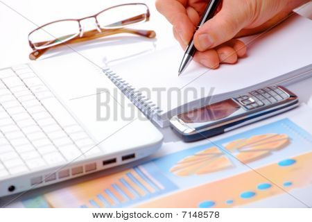 Business Graphs And Male Hand Over Notes
