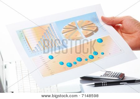 Business Graphs And Male Hand