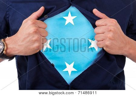 Young Sport Fan Opening His Shirt And Showing The Flag His Country Micronesia, Micronesian Flag