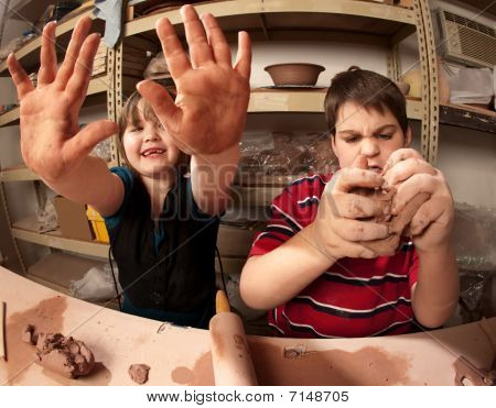 Kids With Messy Hands In Clay Studio