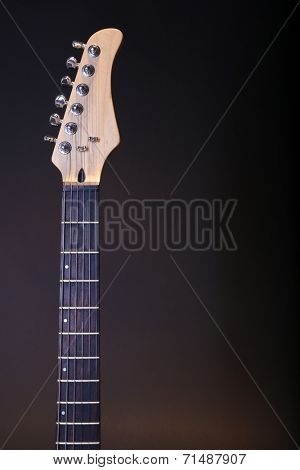 Guitar fretboard on dark background