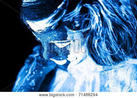 Body art glowing in ultraviolet light