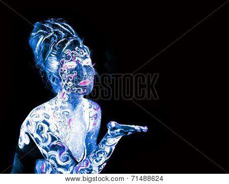 Body art glowing in ultraviolet light, unfocused