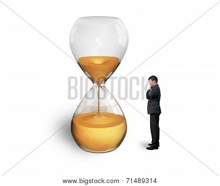 Standing Man Watching The Hourglass