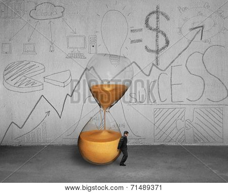 Businessman Holding Inclined Hourglass