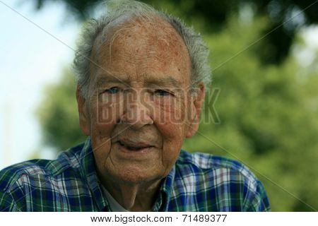 Elderly Man Looking and Thinking