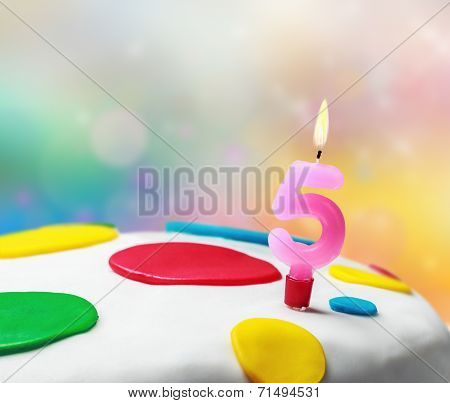 Burning Candle With The Number Five