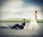 image of runaway  - Funny concept of bound and trapped by marriage - JPG