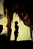 stock photo of cave woman  - Woman silhouette in cave  - JPG