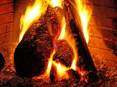picture of log cabin  - wod fire burning in a open fireplace - JPG