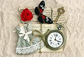 foto of nostalgic  - old love postcards and vintage clock red rose flower key and butterfly - JPG
