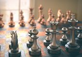 pic of chessboard  - Chessboard with pieces of metal in depth of field view - JPG