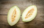 image of muskmelon  - Piel De Sapo Melon On The Wooden Background - JPG