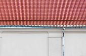 image of downspouts  - Metal rain gutter and downspout on a old house - JPG
