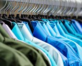 stock photo of racks  - image of many collared shirts hanging on a rack - JPG