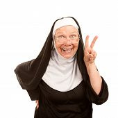stock photo of peace-sign  - Funny nun on white background making peace sign - JPG