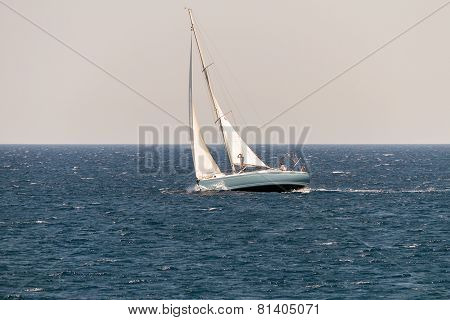 Sailing Vessel In Deep Blue Ocean