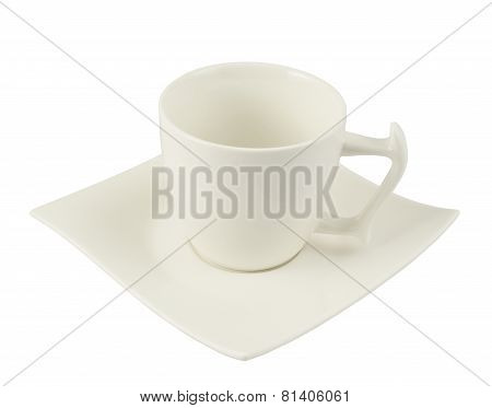 Tea cup over a square plate isolated