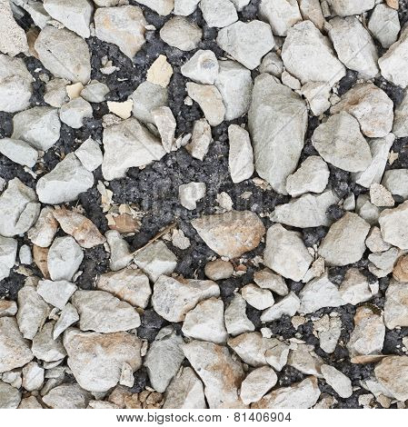 Stone pebbles mixed with asphalt