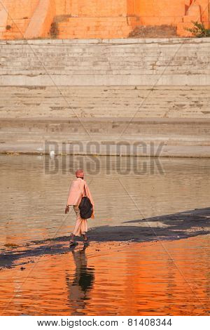 UJJAIN, INDIA - APRIL 25, 2011: Sadhu crossing holy Kshipra river. Shipra is one of the sacred rivers in Hinduism