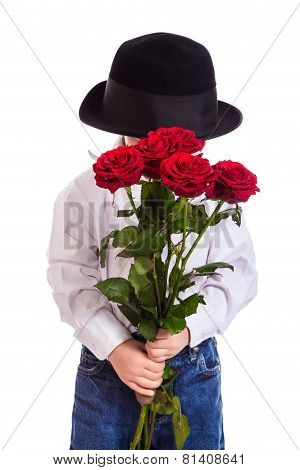 Shy little boy with red roses