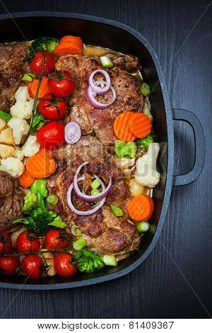 Tasty roasted pork meat with mushrooms and vegetable