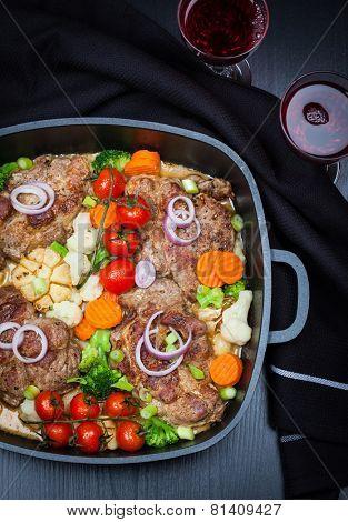 Tasty roasted pork meat with mushrooms and vegetable