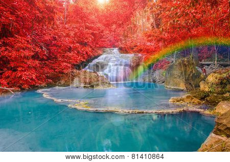 Wonderful Waterfall With Rainbows And Red Leaf In Deep Forest At Erawan Waterfall National Park, Kan