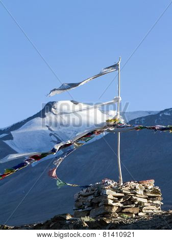 Stupa And Buddhist Prayer Flags On The Wind Against Mountains And Blue Sky