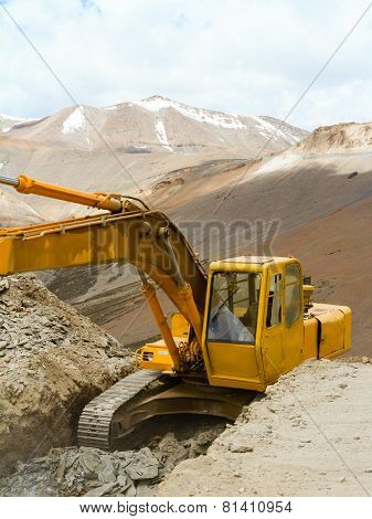 Excavator Working On A Precipice In The Himalayas