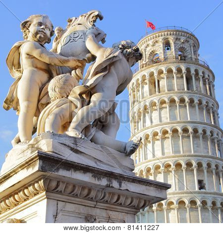 The Leaning Tower of Pisa and La Fontana dei Putti Statue, Italy.