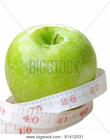 Green Apple Core And Measuring Tape. Diet Concept