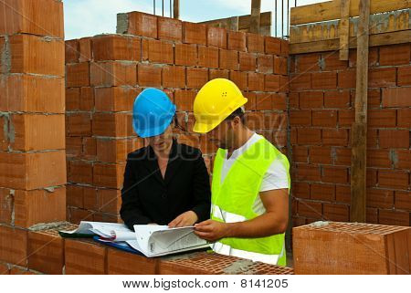 Architects With Documents On Site