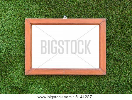 Empty Wooden Photo Frame Hang On Artificial Green Grass Background