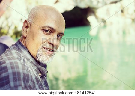 Senior Arabic Pakistani man having islamic religious rite ceremony of ablution face washing